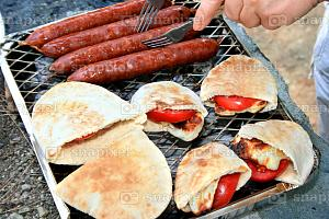 Stock-Photo-of-Grilled-sausageshalloumi-cheese-with-tomatoes-in-pita-bread.jpg